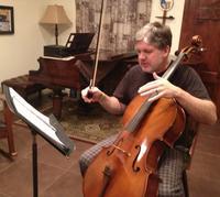 Michael Relland practices his cello