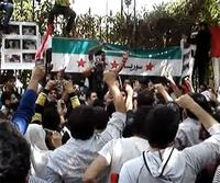 Syrians protest in front of the Syrian embassy in Giza, Egypt