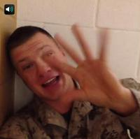 Tim Pierce, a Marine, in a vine while in Afghanistan