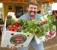 Kurt Alstede with CSA share from Alstede Farms
