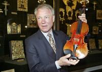 Dietmar Machold holds a 1708 Stradivarius violin in 2003