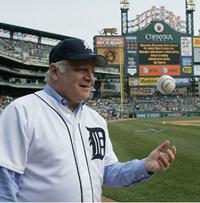 Detroit Symphony Music Director Leonard Slatkin throws out the first pitch at a Detroit Tigers game in October 2011.