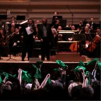 Fans of the Oregon Symphony show support with green handkerchiefs