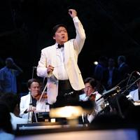 Shanghai Symphony Conductor Long Yu performs at the Shanghai Symphony Orchestra & New York Philharmonic Concert in Central Park, Great Lawn on July 13, 2010