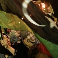 Libyan women shout anti-Gadhafi slogans at Freedom Square on August 22, 2011 in Benghazi, Libya.