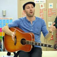 Musician Mat Kearney speaks at a children's songwriting class at the VH1 Save the Music Foundation Family Day at the The Anderson School on October 22, 2011 in New York City.