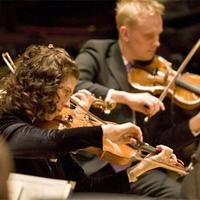 Violinists Dale Barltrop and Daria T. Adams of the St. Paul Chamber Orchestra