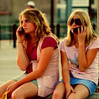 girls talking on cell phones