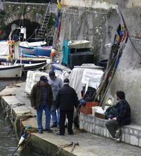 Fishermen in Vambolieri, italy
