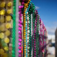 Mardi Gras Beads on a Police Baricade after the Spanish Town Parade