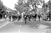 The 327th Army Band marches along Bonaparte Avenue in Baltimore in 1969.