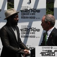 Mayor Bloomberg and the Black Eyed Peas' will.i.am shake hands on the roof of  the parks building on 5th Avenue.