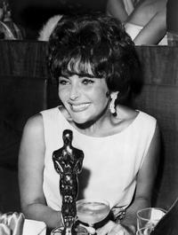 Elizabeth Taylor poses in 1961 with the Oscar she won for her role as a call girl in