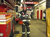 Firefighter Shane Clarke wearing almost 130 pounds of gear.