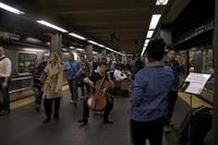 Dale Henderson performs Bach on a Times Square subway platform for Bach In The Subways Day.