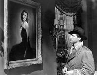 Gene Tierney as Laura, with Dana Andrews in