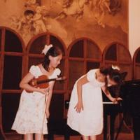 Amy Chua's daughters, Lulu (violin) and Sophia (piano) take a bow after a recital.