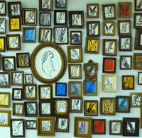 A wall devoted to paintings at Hunt Slonem's studio