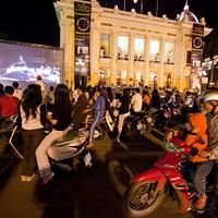 Crowds gather outside the Hanoi Opera House to watch the New York Philharmonic's Vietnam debut, October 16, 2009.
