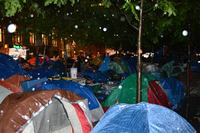 Rain falls on the tents of Occupy Wall Street protesters in Zuccotti Park on Saturday evening.