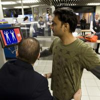 A passenger undergoes a security scan at Schiphol airport, on December 28, 2009.