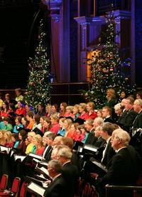 The Bach Choir performs John Rutter's Christmas music with the Royal Philharmonic at the Royal Albert Hall