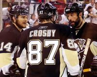 Sidney Crosby, Bil Guerin and Chris Kunitz huddle before an offensive zone faceoff during the third period of the Pittsburgh Penguins 2009 Stanley Cup Finals game 6 against the Detroit Red Wings.
