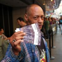 An Andrea Bocelli fan displays his tickets for the Central Park Concert
