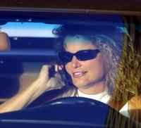 Lady talking on cell phone while driving