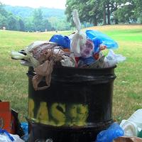 An overflowing garbage can in Brooklyn's Prospect Park