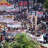 Some of 20,000 demonstrators march during a protest marking the 24-hour gerneral strike against the austerity measures in central Athens on May 20, 2010.