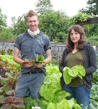 Caleb Leech and Ariel Nadelberg standing among the Brooklyn Botanic Garden's amaranth plants