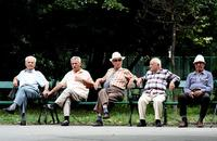 A group of elderly Romanian men relax.