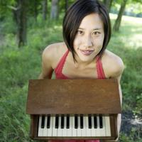 Phyllis Chen and her toy piano