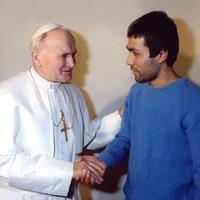 Pope John Paul II greets Mehmet Ali Agca at Rome's Rebibbia prison on December 27, 1983.