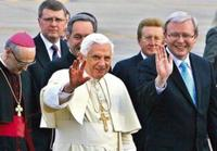 Pope Benedict XVI greets a crowd while on a visit to Australia. By his side is Prime Minister of Australia Kevin Rudd.