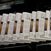 Copies of the San Francisco Chronicle roll off the printing press.