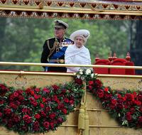 Queen Elizabeth and the Duke of Edinburgh onboard the Royal Barge to celebrate the Queen's Diamond Jubilee at the River Pageant on the Thames River