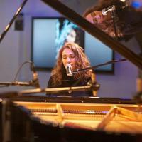 Regina Spektor performing in WNYC's Greene Space
