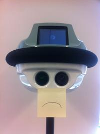 Rachel Emma Silverman's QB-82 Robot. Her Wall Street Journal colleagues posted a sad face on the QB-82 when the Wi-Fi signal failed.
