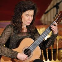 Grammy award-winning guitarist Sharon Isbin performs during a classical music workshop and concert November 4, 2009 in the East Room of the White House.