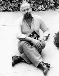 Philip K. Dick, holding a copy of