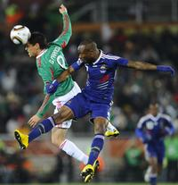 Mexico's striker Guillermo Franco (L) challenges France's defender William Gallas during the 2010 World Cup group A first round football match between Mexico and France on June 17, 2010