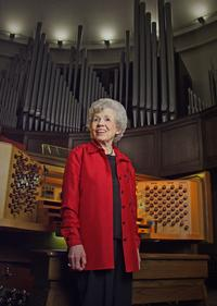 Wilma Jensen in front of the Casavant console  at St. George's Episcopal Church in Nashville.