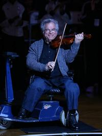Itzhak Perlman plays the National Athem before a Brooklyn Nets and the Orlando Magic game at the Barclays Center on January 28, 2013