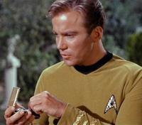 Captain Kirk using a communicator in Star Trek