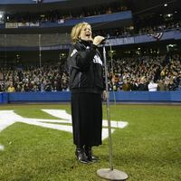 Renee Fleming sings the national anthem prior to game two of the World Series between the Florida Marlins and the New York Yankees on October 19, 2003 at Yankee Stadium in the Br
