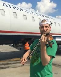 Zach De Pue performs at Charlotte Douglas International Airport