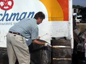 Principal percussionist Chris Lamb testing some oil drums
