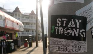 A sticker reading 'Stay Strong' is stuck to a telephone pole near the boardwalk in Seaside Heights, NJ. Everyone is hoping for a brisk business on Memorial Day. coastcheck